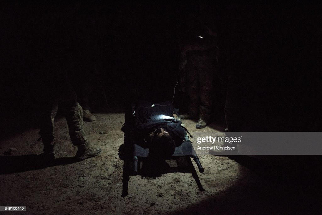 Members of the Afghan Special Forces work on a casualty during a casevac night training of Afghanistan Special Forces by the United States Army Special Forces Operational Detachment Alpha on September 10, 2017 at Camp Shorab in Helmand Province, Afghanistan. Currently the United States has about 11,000 troops in the deployed in Afghanistan, with a reported 4,000 more expected to arrive in the coming weeks. With the arrival of more troops, Resolute Support, the coalition train, advise, and assist mission, hopes to train almost double the amount of Afghan Special Forces and Special Police Units.