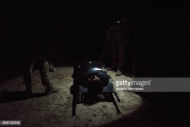 Members of the Afghan Special Forces work on a casualty during a casevac night training of Afghanistan Special Forces by the United States Army...