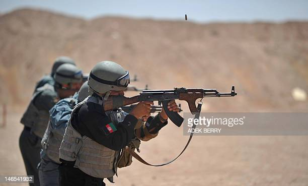 Members of the Afghanistan National Policemen fire their AK47 rifles during shooting course taught by US Marines at Camp Leatherneck in Helmand...