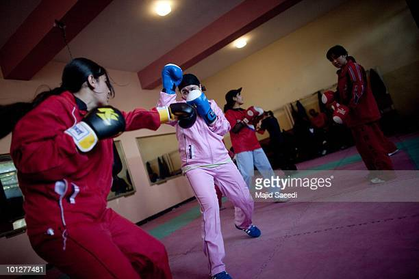 Members of the Afghanistan women's national boxing team attend a training session in the National Olympic Stadium on May 3 2010 in Kabul Afghanistan...