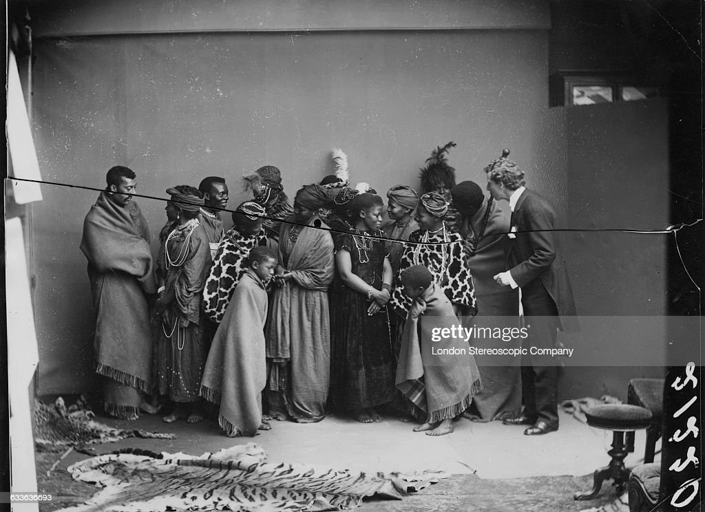 Members of The African Choir at a shoot for a group portrait with their English musical director James Balmer (far right), 1891. The choir, drawn from seven different South African tribes, toured Britain from 1891 to 1893 to raise funds for a technical college in their home country. Their best known performance was before Queen Victoria at Osborne House, the royal residence on the Isle of Wight, in 1891.