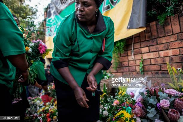 Members of the African National Congress Women's League arrive to lay flowers outside the home of the late South African antiapartheid campaigner...