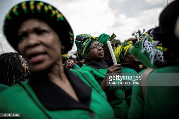 A members of the African National Congress Women's League holds a candle outside the home of the late South African antiapartheid campaigner Winnie...