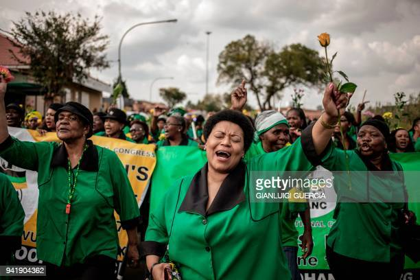 TOPSHOT Members of the African National Congress Women's League march to commemorate the late South African antiapartheid campaigner Winnie...