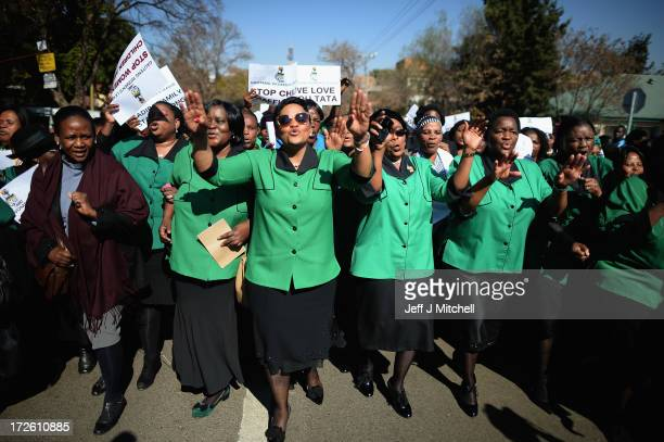 Members of the African National Congress Women's League sing and pray outside the Mediclinic Heart Hospital where former South African President...