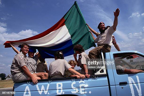 Members of the Afrikaner Resistance Movement a neoNazi rightwing organization ride in the back of a pickup truck campaigning on referendum voting day...