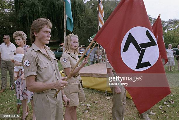 Members of the Afrikaner Weerstandsbeweging a rightwing political party in South Africa hold the flag of their party