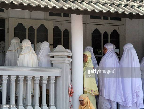 Members of the Ahmadiyah community attend Friday prayers at the AnNur Mosque in Manis Lor village in Kuningan West Java on August 5 2011 Indonesian...