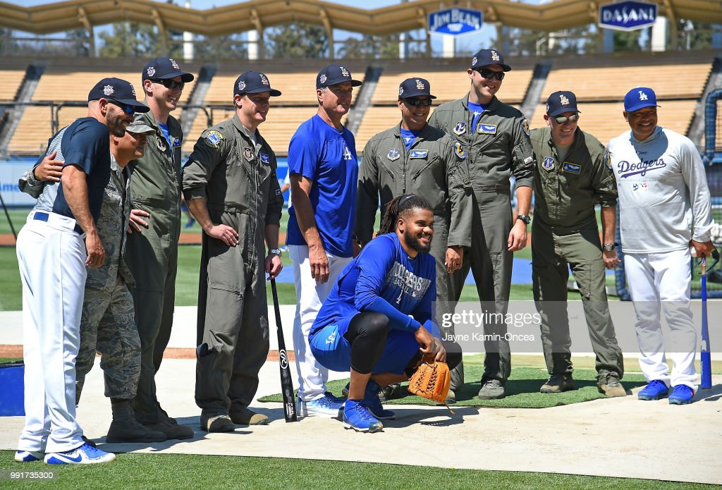 Members of the Air National Guard 144th Fighter Wing ground crew pose for a photo with Chris Woodward #45, Bob Geren #8, Kenley Jansen #74 and manager Dave Roberts #30 of the Los Angeles Dodgers after taking batting practice before the game against the Pittsburgh Pirates at Dodger Stadium on July 4, 2018 in Los Angeles, California.