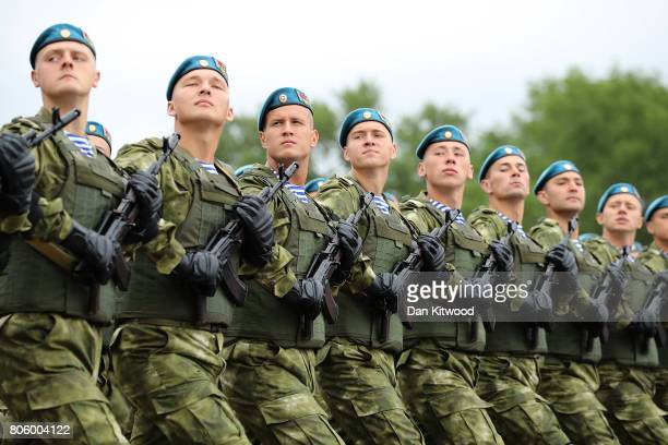 Members of the Airbourne Division march past Belarusian President Alexander Lukashenko on July 3 2017 in Minsk Belarus The parade included around...