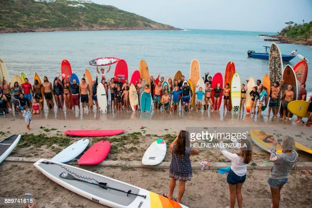 Members of the Ajoe Reefer Surf Club pose for a group photo by the Anse de Marigot beach on the French Caribbean island of SaintBarthelemy as they...