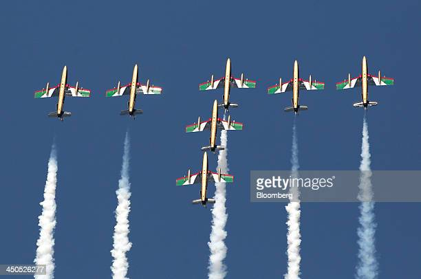 Members of the Al Fursan aerobatic display squad flying aircraft manufactured by Alenia Aermacchi SpA perform an aerial display during the 13th Dubai...