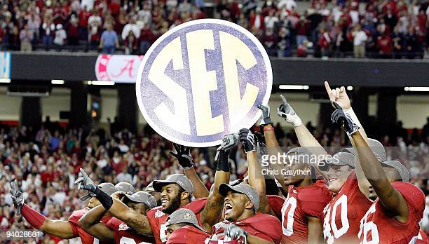 Members of the Alabama Crimson Tide celebrate after defeating the Florida Gators 3113 during the SEC Championship at the Georgia Dome on December 5...