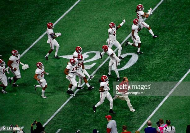 Members of the Alabama Crimson Tide take the field before the CFP National Championship presented by ATT against the Georgia Bulldogs at MercedesBenz...