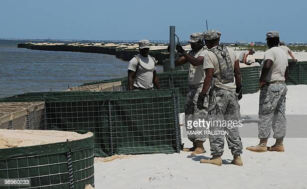 Members of the Alabama National Guard prepare a sea wall as a defense against the expected oil slick from the BP Deepwater Horizon platform disaster...
