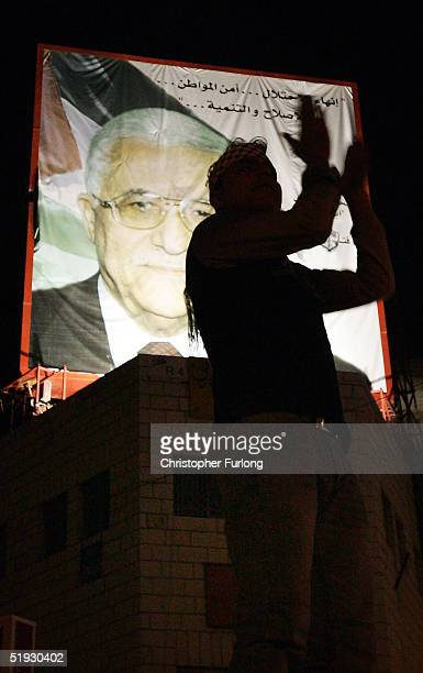 Members of the alAqsa Martyrs Brigades celebrate after presidential candidate Mahmud Abbas declared a victory January 9 2005 in Ramallah West Bank...