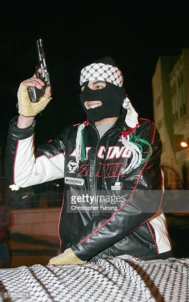Members of the alAqsa Martyrs Brigades celebrate by firing guns in the air after presidential candidate Mahmud Abbas declared a victory January 9...