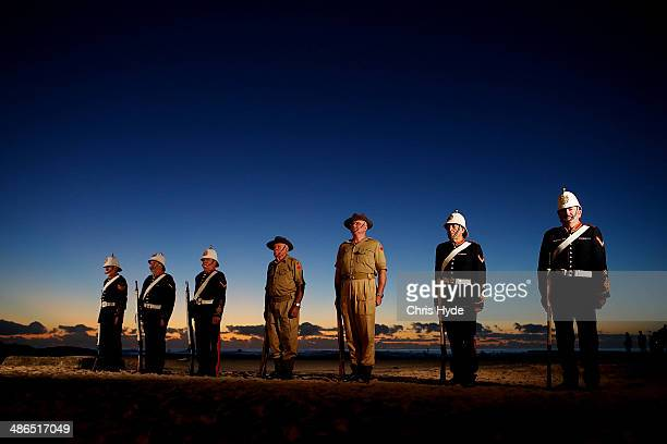 Members of the Albert Battery stand guard during the ANZAC dawn service at Currumbin Surf Life Saving Club on April 25 2014 in Gold Coast Australia...