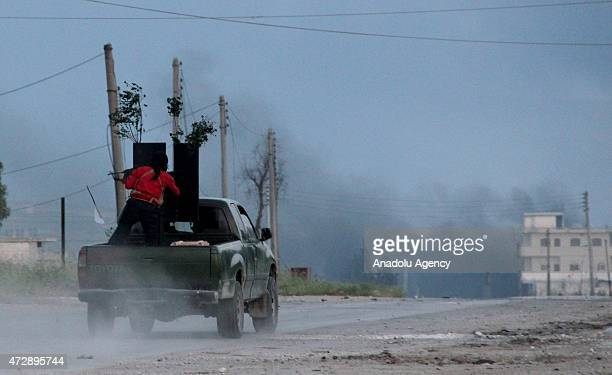 Members of the alFatah Forces attack Assad regime forces near to the alWatan Hospital in Jisr alShughur District in Idlib Syria on MAy 10 2015