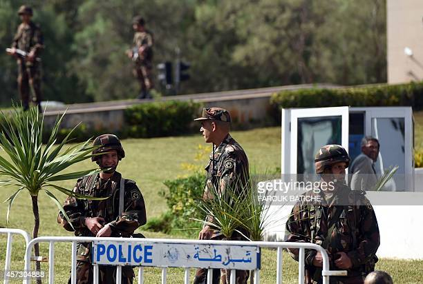 Members of the Algerian Republican Guard stand guard outside the presidential palace on October 16 2014 in the capital Algiers as police forces...
