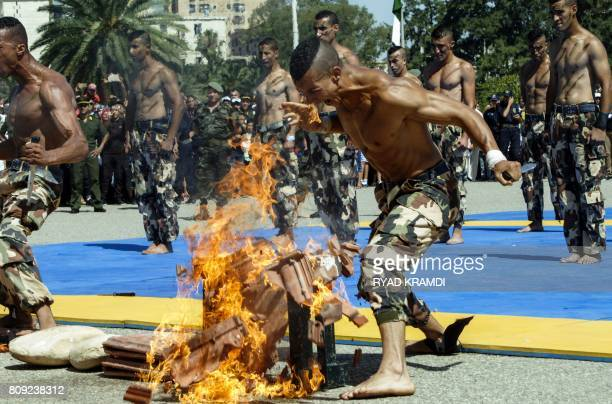 Members of the Algerian Special Forces demonstrate their martial arts skills as they perform by the Army Museum at the Esplanade of Ryad elFeth on...