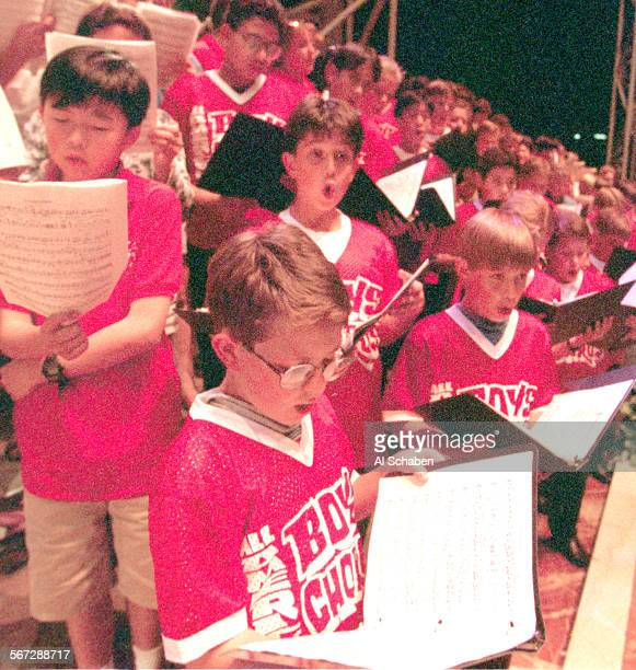 Members of the All American Boys Choir sing with 700 mixed choir and symphony members as they rehearse Monday evening for the Behemoth Mahler...