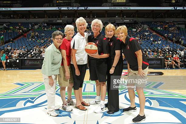 Members of The All American Red Heads Women's Basketball Team on the court prior to the game between the Chicago Sky and the Minnesota Lynx on June...