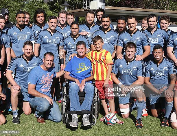 Members of the All Blacks squad pose with former Springbok Joost van der Westhuizen who now suffers with motor neurone disease after the All Blacks...