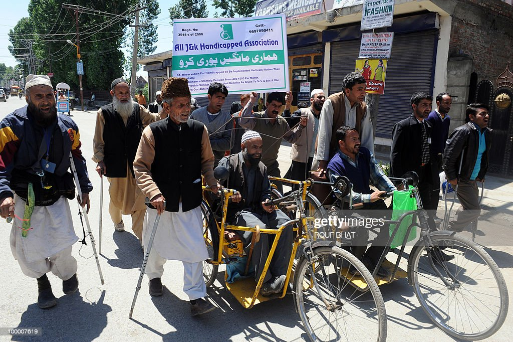 Members of the All Jammu and Kashmir Handicapped Association (AJKHA) march towards the civil secretariat which houses the office of chief minister Omar Abdullah, in Srinagar on May 20,2010. The All Jammu and Kashmir Handicapped Association (AJKHA) were demanding an increase in monthly pensions and free education for deaf and blind handicapped people . AFP PHOTO/Rouf BHAT
