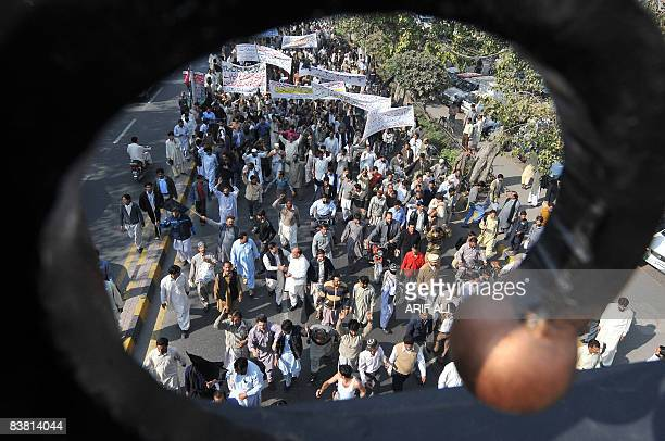 Members of the All Pakistan Clerks Association march against rising inflation in Lahore on November 25 2008 The International Monetary Fund said its...