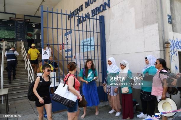 Members of the Alliance Citoyenne association gather in front of the Jean Bron municipal swimming pool in Grenoble centraleastern France after the...