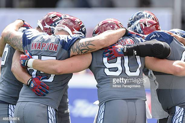 Members of the Alouettes huddle during the CFL game against the Hamilton TigerCats at Percival Molson Stadium on September 7 2014 in Montreal Quebec...