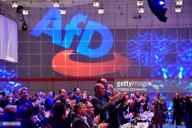 Members of the Alternative for Germany farright party applaud during the congress of the AfD on December 2 2017 in Hanover northern Germany The...