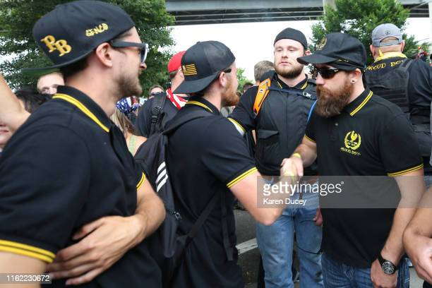 Members of the alt-right group, Proud Boys, shake hands during the End Domestic Terrorism rally on August 17, 2019 in Portland, Oregon. Anti-fascism...