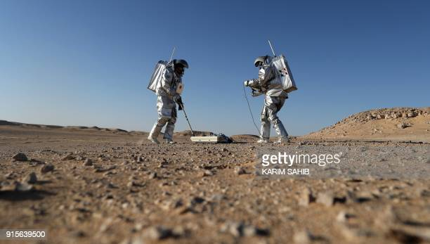 TOPSHOT Members of the AMADEE18 Mars simulation mission wear spacesuits while conducting scientific experiments during an analog field simulation in...
