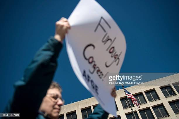 Members of the American Federation of Government Employees gather during a rally on outside the Department of Labor on March 20 2013 in Washington DC...