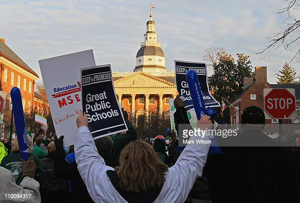 Members of the American Federation of State County and Municipal Employees Union participate in a rally in front of the Maryland State Capitol...