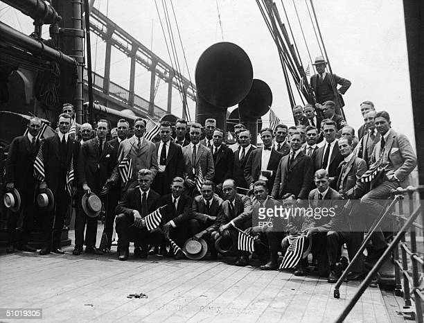 Members of the American Olympics team on the transport ship Sherman pass under a bridge as they set sail to Antwerp 1920 Among the athletes are 20...