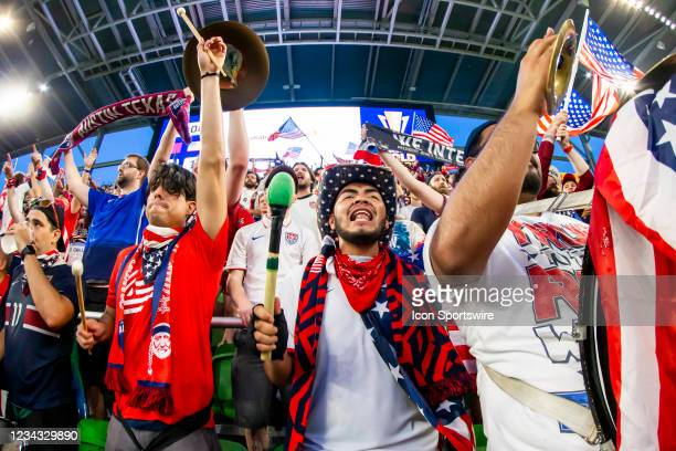 Members of the American Outlaws supporters section celebrate the US win during the Gold Cup semifinal match between the United States and Qatar on...