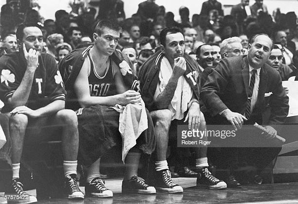 Members of the American professional basketball team the Boston Celtics including Bob Cousy Tom Heinsohn and their legendary coach Red Auerbach sit...