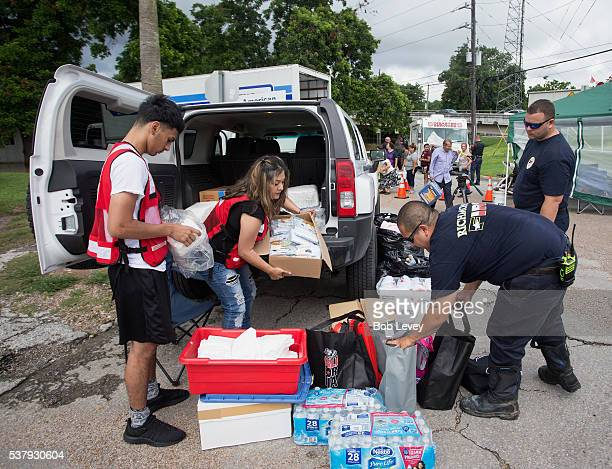 Members of the American Red Cross along with Gabe Escochea and Brett Hafer of the Richmond Fire Department prepare items for flood stricken famlies...