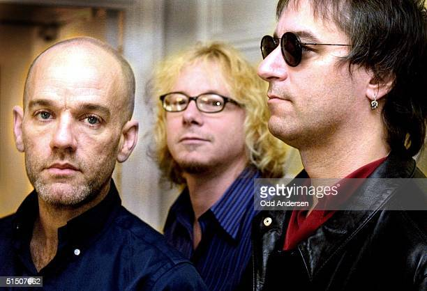 Members of the American rock group REM from L Michael Stipe Mike Mills and Peter Buck poses for media during a photocall in London 27 April 2001 The...