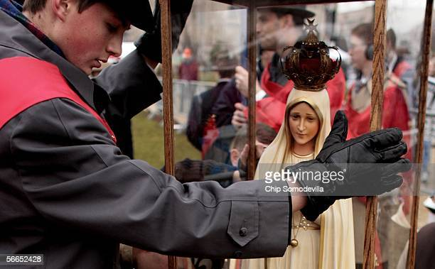 Members of the American Society of the Defense of Tradition Family and Property encase one of the Pilgrim Virgin Statues of Our Lady of Fatima in...