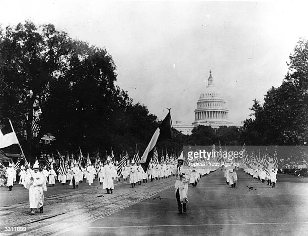 Members of the American white supremacist organisation the Ku Klux Klan parade down Pennsylvania Avenue from the capitol to the treasury Washington...