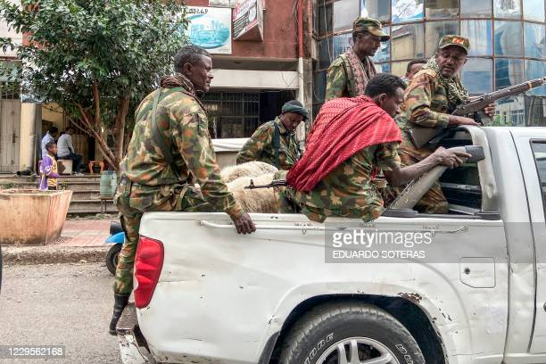 TOPSHOT Members of the Amhara militia that combat alongside federal and regional forces against northern region of Tigray ride on the back of a pick...