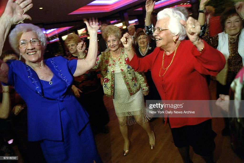 Members of the Amico Senior Center dance at their annual holiday party at the Rex Manor in Bensonhurst, Brooklyn.