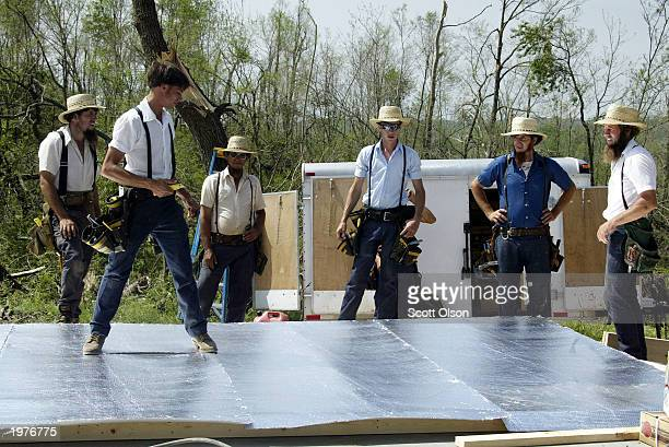 Members of the Amish community help a fellow church member rebuild his tornado damaged home and tool shed May 6 2003 near Verona Missouri Tornados...