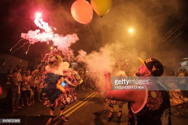 Members of the Amizade batebola street carnival band parade during the first day of carnival in Rio de Janeiro Brazil on February 23 2017 The...