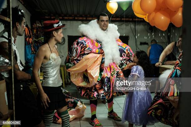 Members of the Amizade batebola street carnival band prepare for their first day of carnival in Rio de Janeiro Brazil on February 23 2017 The...