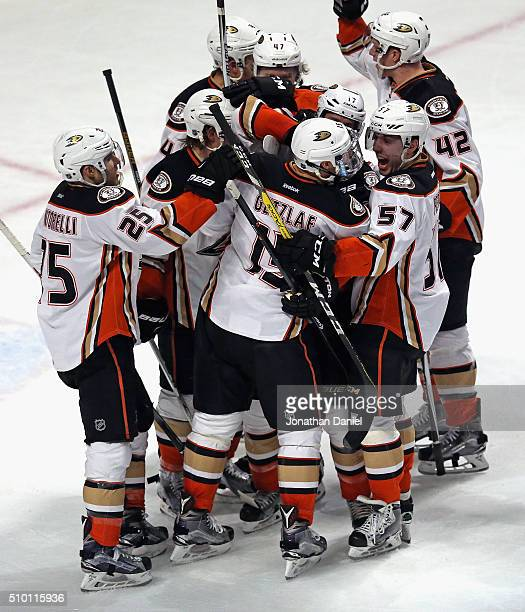 Members of the Anaheim Ducks including Mike Santorelli and David Perron mob Ryan Getzlaf after Getzlaf scored the game-winning goal in overtime...